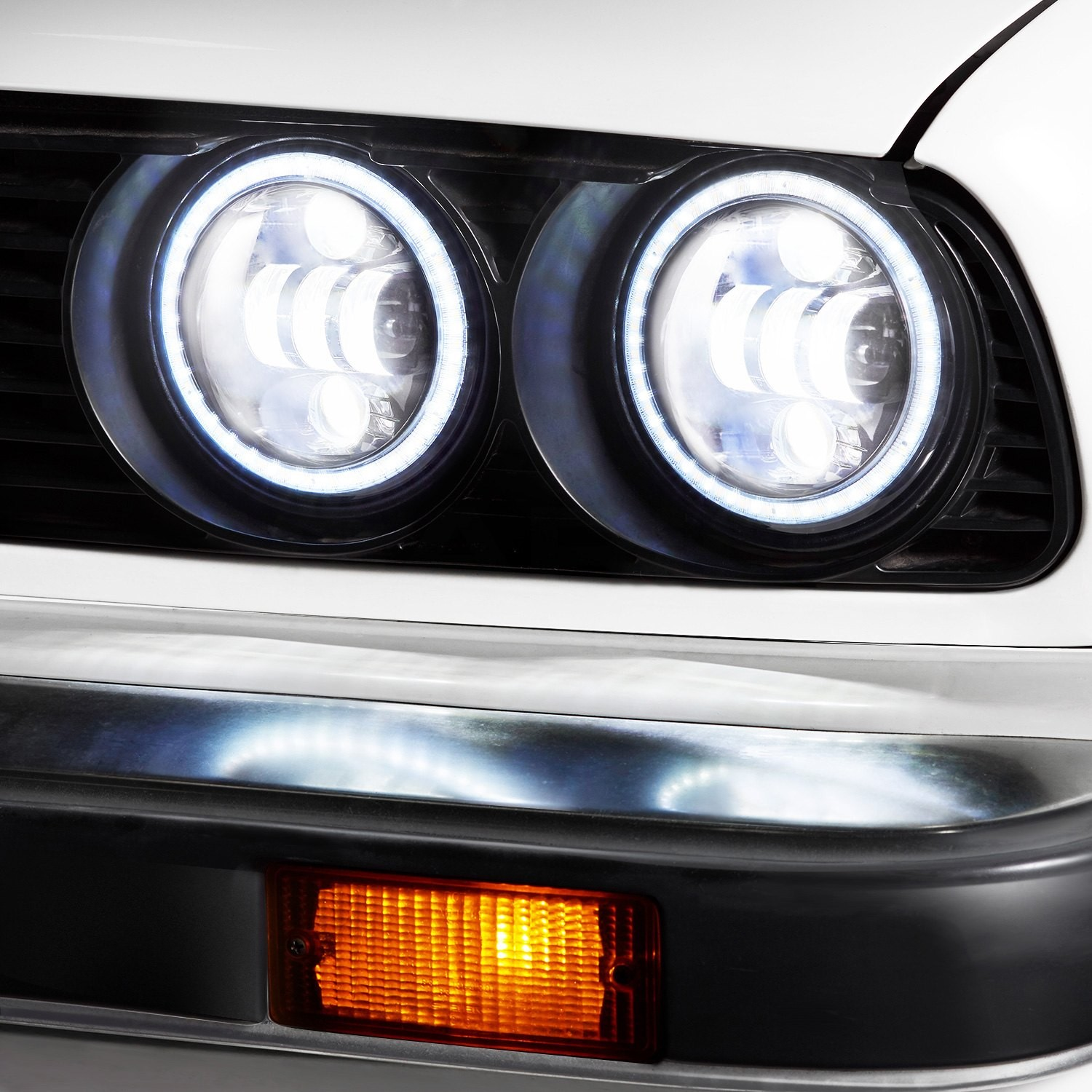 """5 3 4"""" Round Black Projector LED Headlights with Switchback Halo Installed on a BMW 3 Series High Beam Light"""