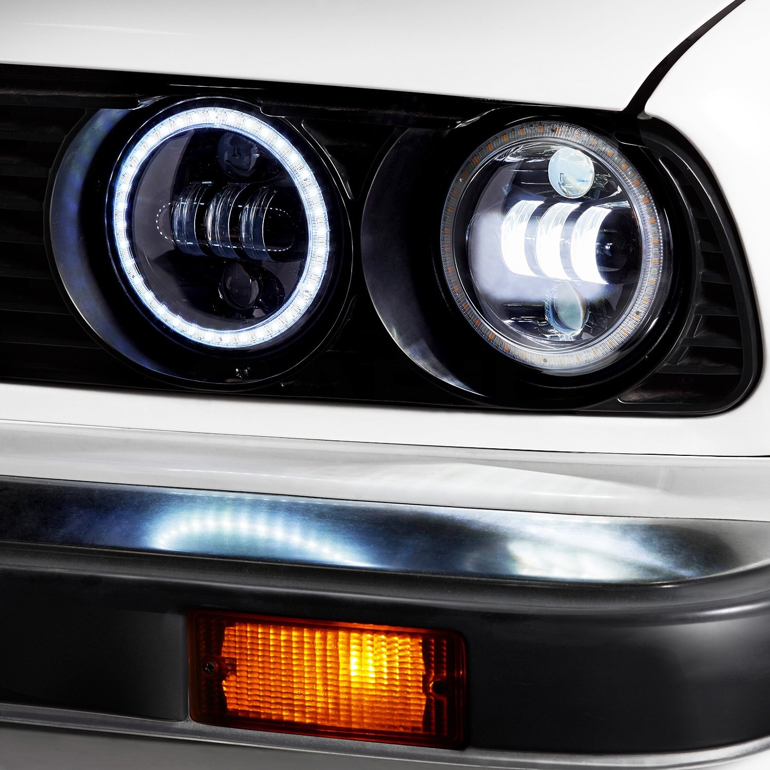 """Round Black Projector LED Headlights with Switchback Halo Installed on a BMW 3 Series Lights fLumen 5 3 4"""" Round Black Projector LED Headlights"""