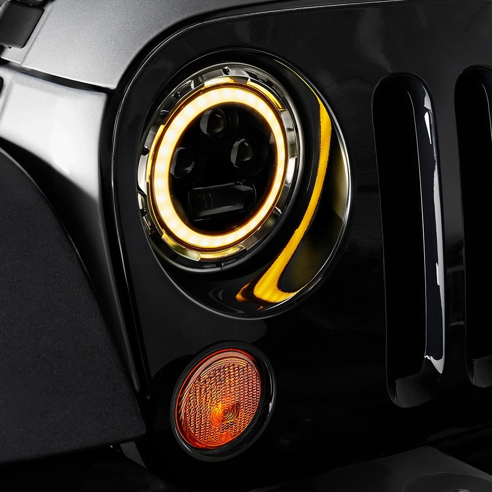 """Round Black RGB Halo Projector LED Headlights with Bluetooth Control Mobile AppLumen 7"""" Round Chrome Projector LED Headlights with Switchback Halo"""