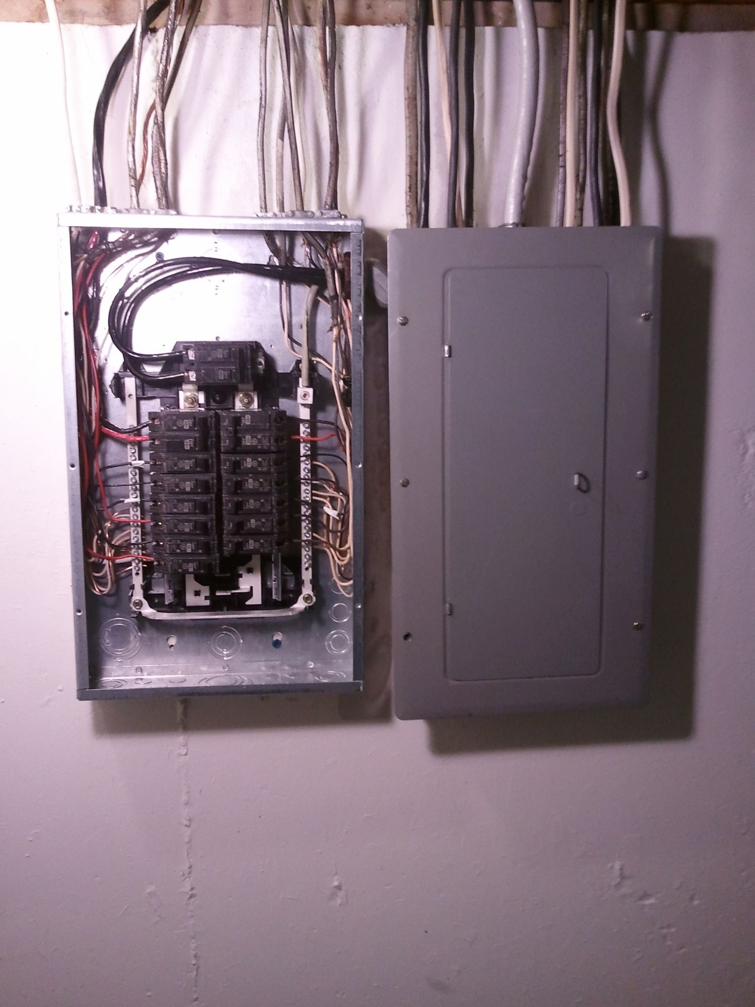 Electrical panel and subpanel with cover removed from subpanel bc5f9b58bdb38ad559