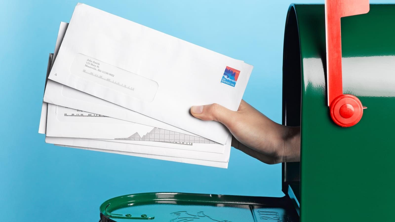 hand holding mail mailbox typ